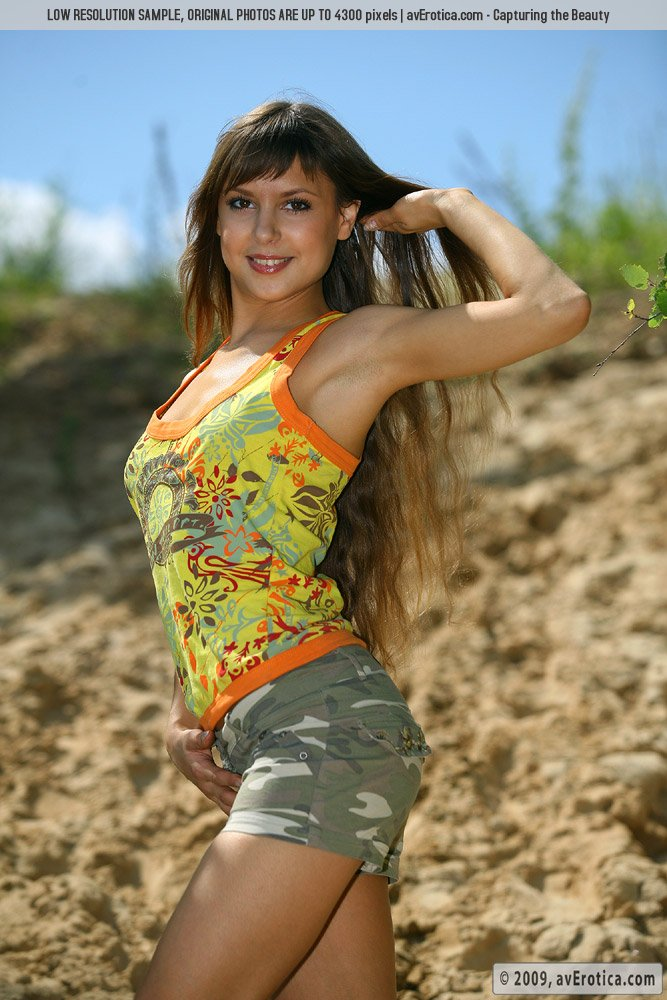 Gorgeous and tanned brunette Basia taking off her funny clothes