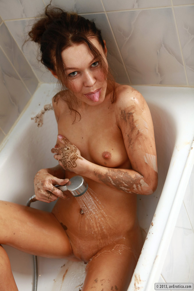 Horny babe Brigitte never minds taking a shower with a camera
