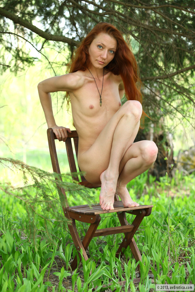 Redhead skinny Kessy undresses, while posing somewhere outdoors