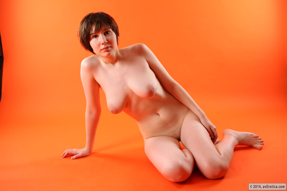 Busty Hope nude and seductively amazing against the orange background